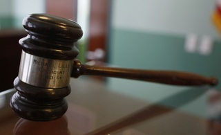 Ex-immigration agent gets prison for bribery