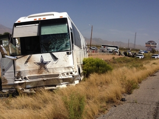 Van in crash with Cowboys bus failed to yield