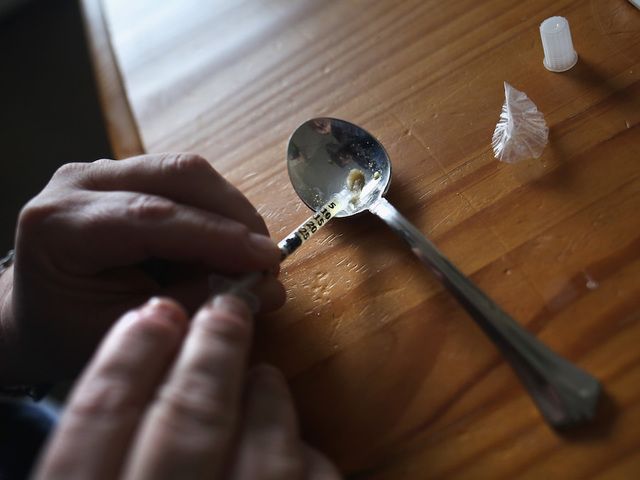 Dozens treated as heroin overdose spikes hit several states