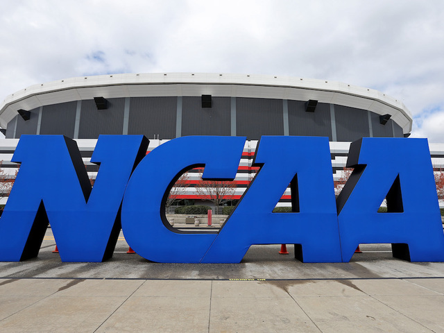 USA  charges four college basketball coaches in bribery scheme