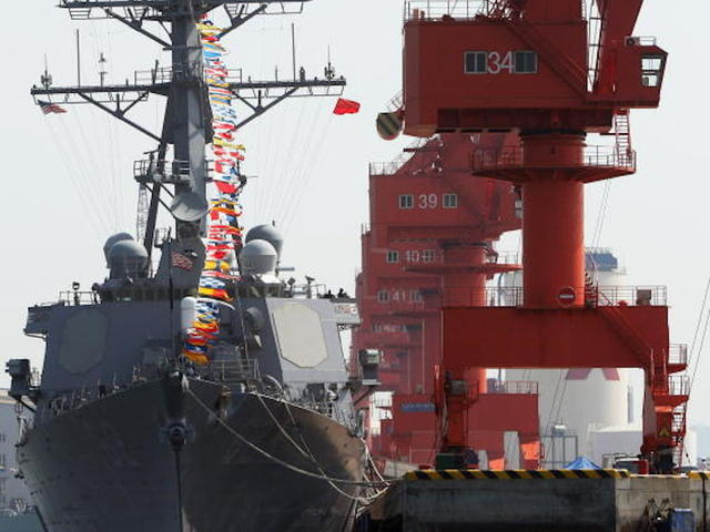 United States destroyer returns to port; 7 missing