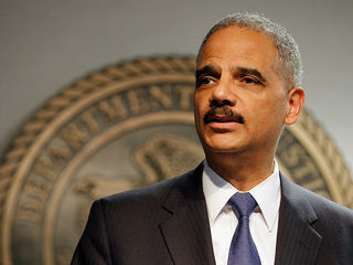 Holder challenges head of voter fraud committee