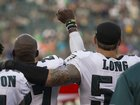 Philadelphia Eagle hugs teammate during protest