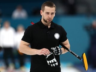 Olympic Russian curler agrees to return medal