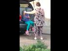 2 children seen in pet kennels in truck