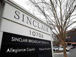 6 TV companies settle DOJ antitrust charges